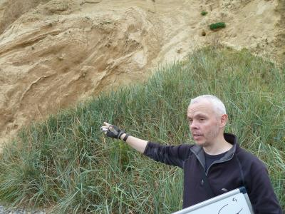 Scientist interpreting Ice Age deposits in the field
